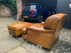 Beautiful vintage art deco leather arm chair with footstool. Howard & Son style