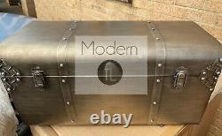 Set of 2 industrial style antique silver storage trunks